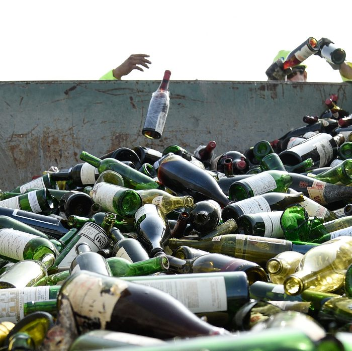 More than 500 bottles of wine found to be counterfeit or unsellable are destroyed at a landfill in Creedmoor, Texas, Dec. 10, 2015. The wine was from the private collection of Rudy Kurniawan, the man convicted of fraud in federal court in 2013 for producing and selling millions of dollars of counterfeit wine. The U.S. Marshals were responsible for destroying the counterfeit and unsellable wine and selling the authentic wine. At the destruction, the wine bottles are crushed by a crane, and the glass is collected for recycling on site. The liquid contents of the bottles are collected and composted. The cardboard and wood from the boxes and pallets are also recycled or composted. Photo By Brien Aho for the US Marshals