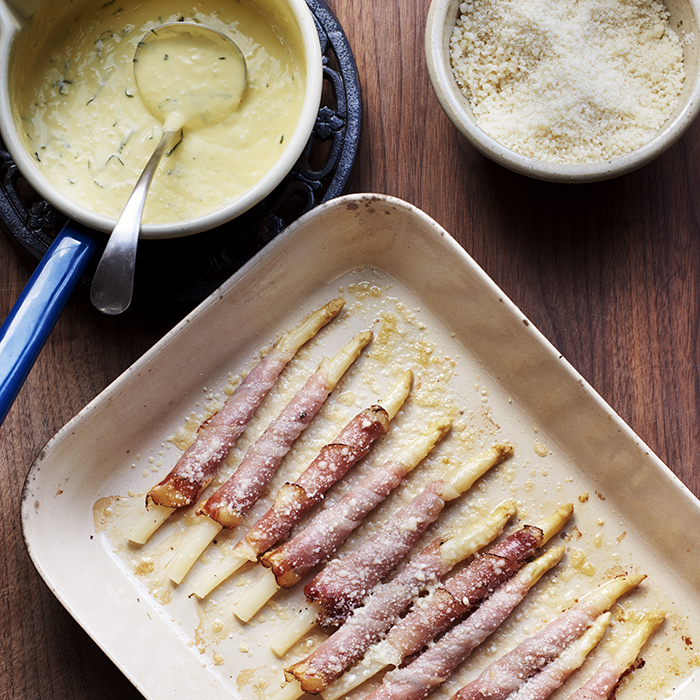 Asparagus spears wrapped in speck and brushed with butter and Parmesan: the perfect foil for Riesling Spätlese. Photograph: Joe Woodhouse