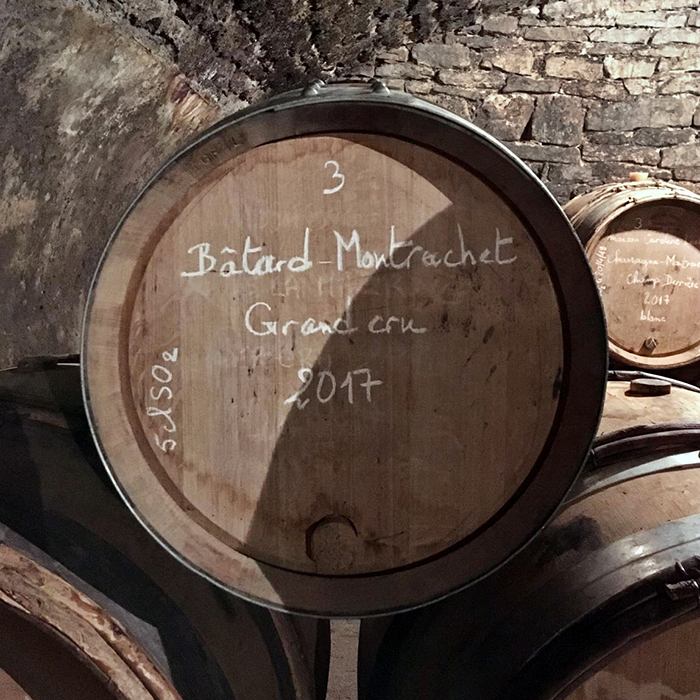 A barrel of 2017 Batard-Montrachet in the cellar at Jean-Noel Gagnard