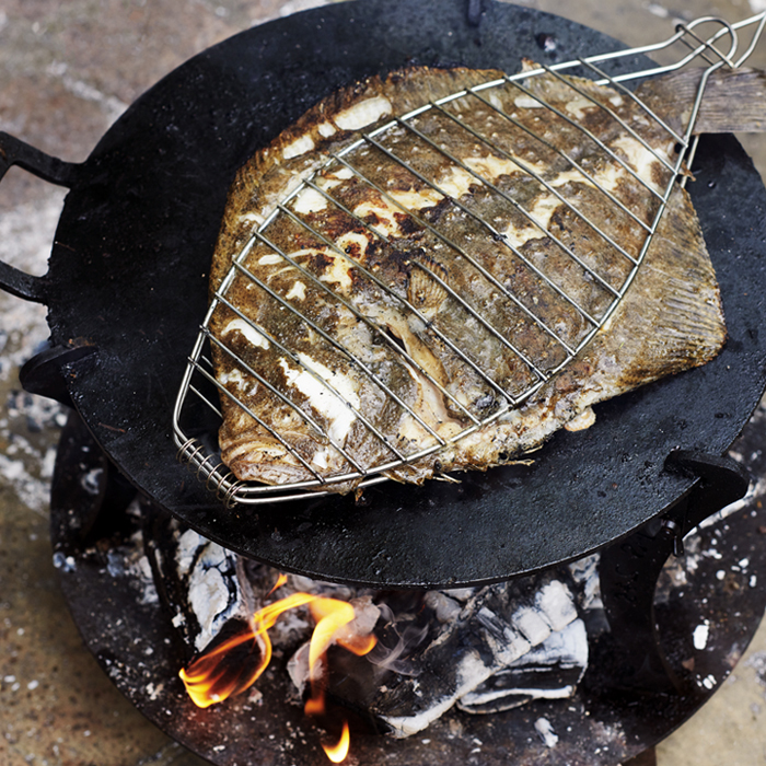 A Brat-inspired turbot cooked over coals. Photograph: Joe Woodhouse