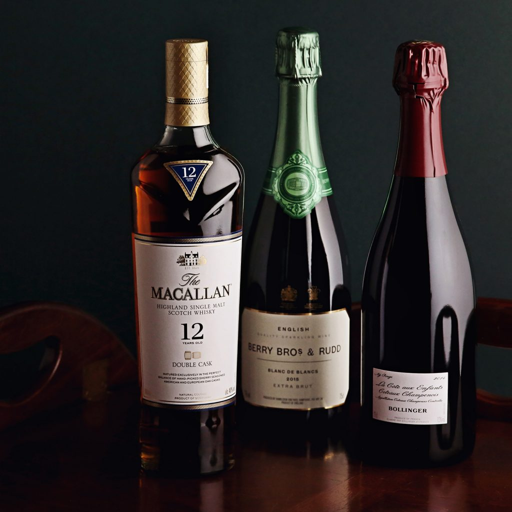 This image shows a line-up of wines and spirits selected by our staff, featuring an English sparkling wine, Bollinger's Pinot Noir and The Macallan Whiskey.