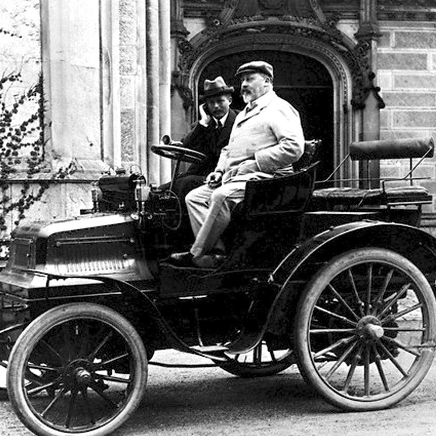 King Edward VII was an avid motorist. This image shows him sitting in one of his Daimler cars.