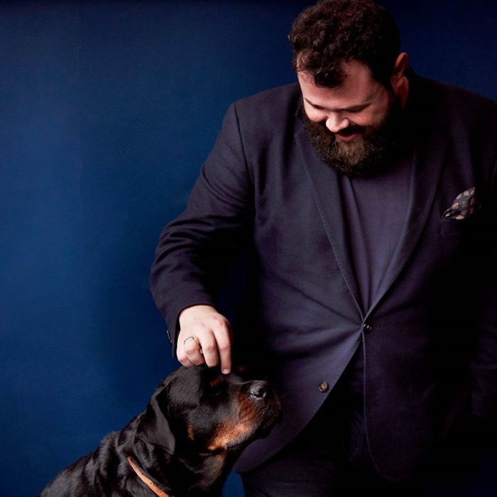 A portrait of Charlie Mellor – one of the co-founders of Big Night – and his dog.
