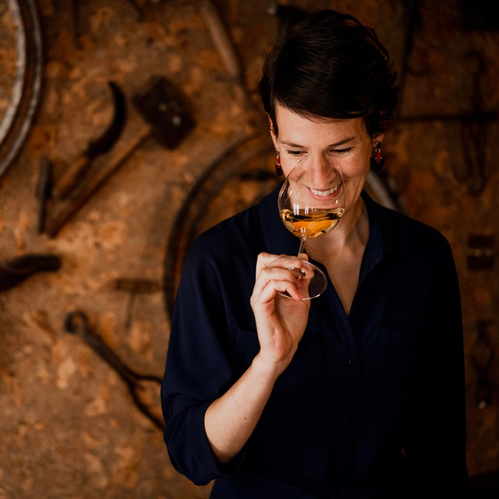 Barbara Drew MW noses a glass of white wine in the tasting room at No.3 St James's Street.