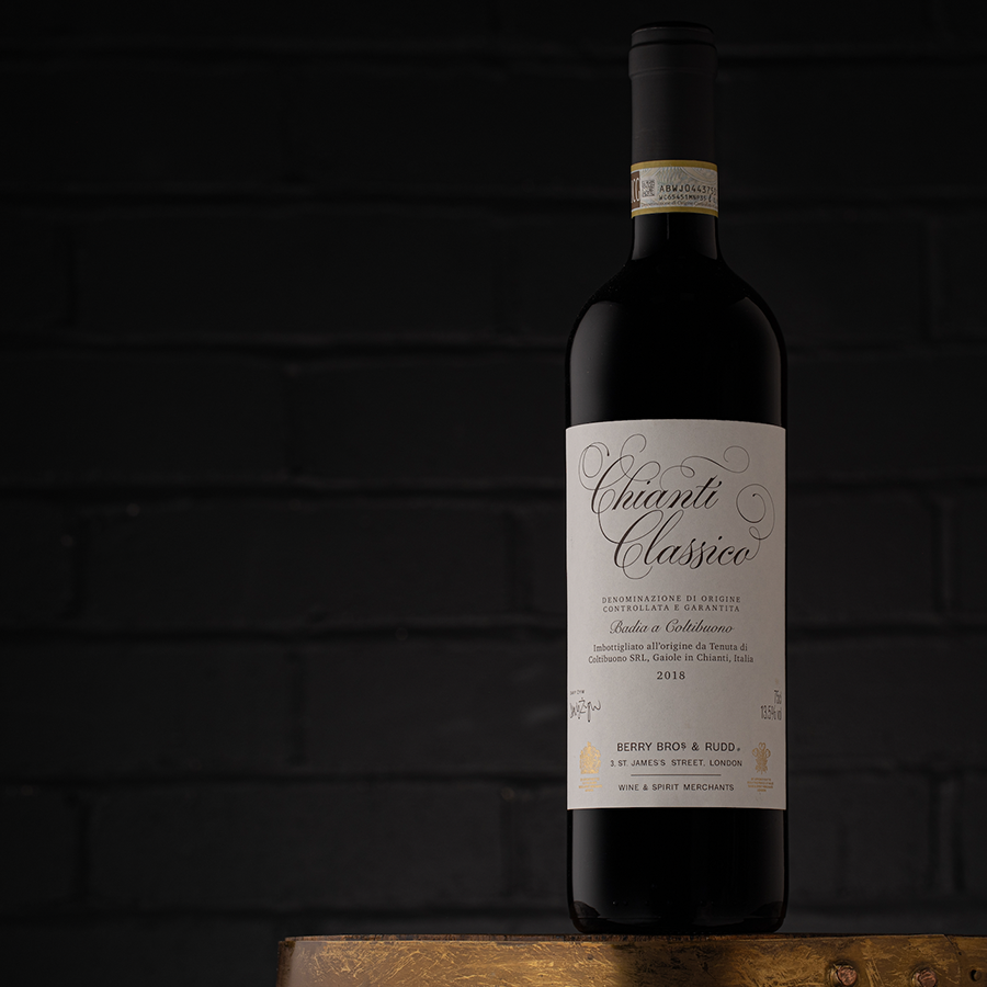 A photo of the latest vintage of our Own Selection Chianti, shot against a black wall