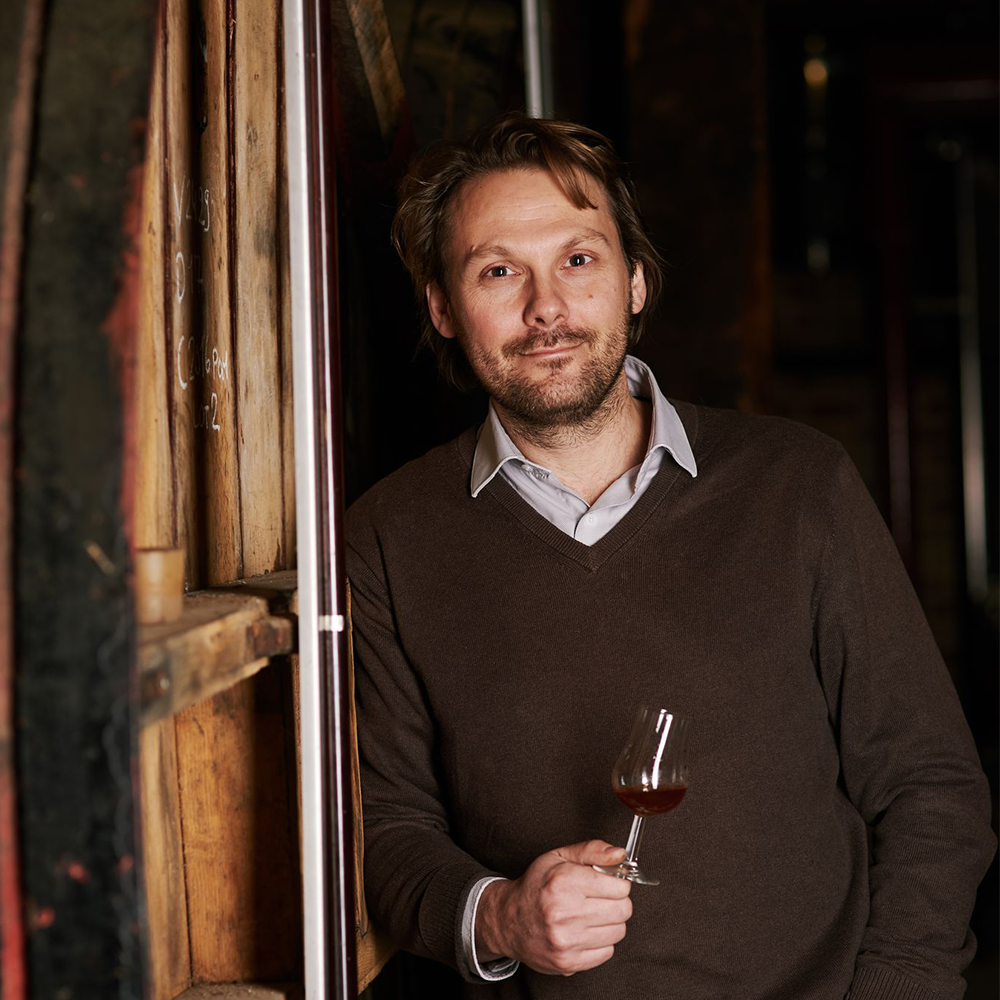 An image of Guillaume Drouin in his distillery in Normandy