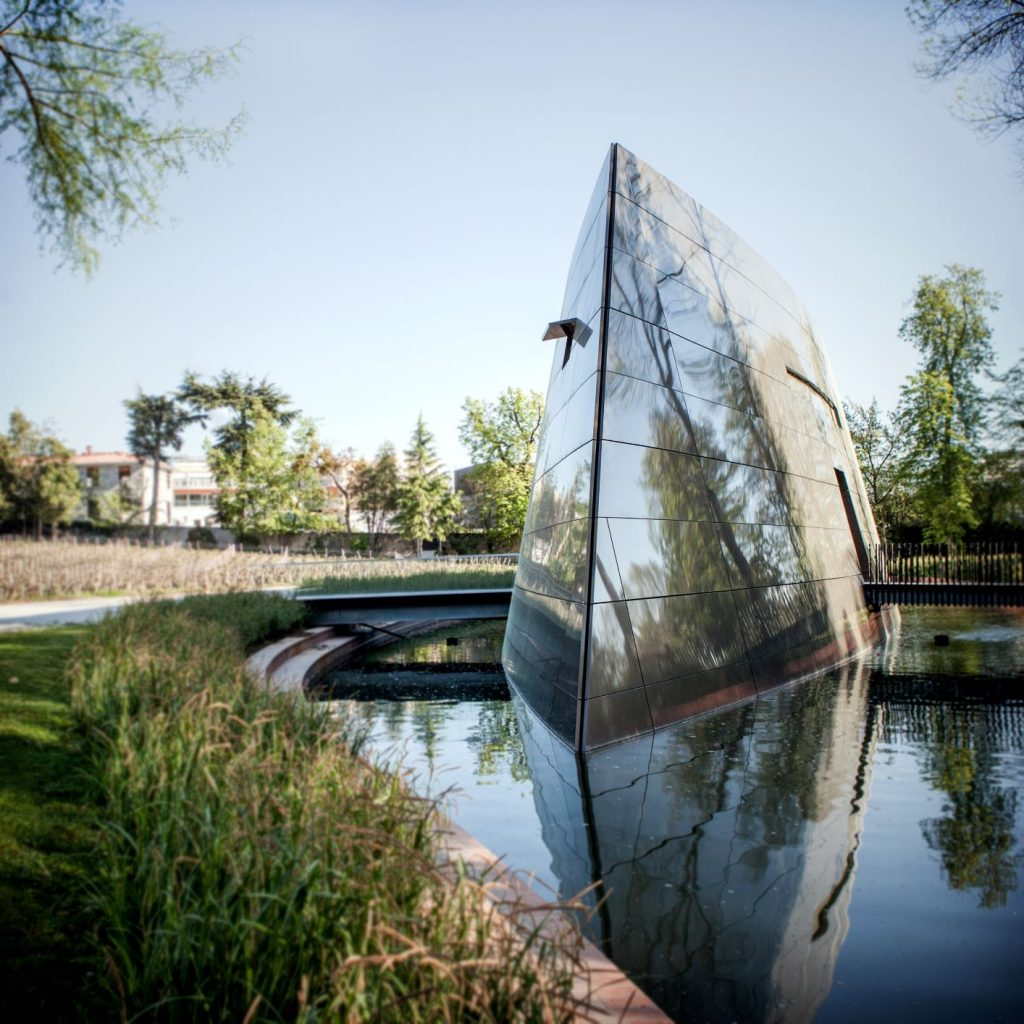 A small river that flows through the les Carmes estate is bisected by an impressive silver-prow of the boat-like Philippe-Starck designed winery