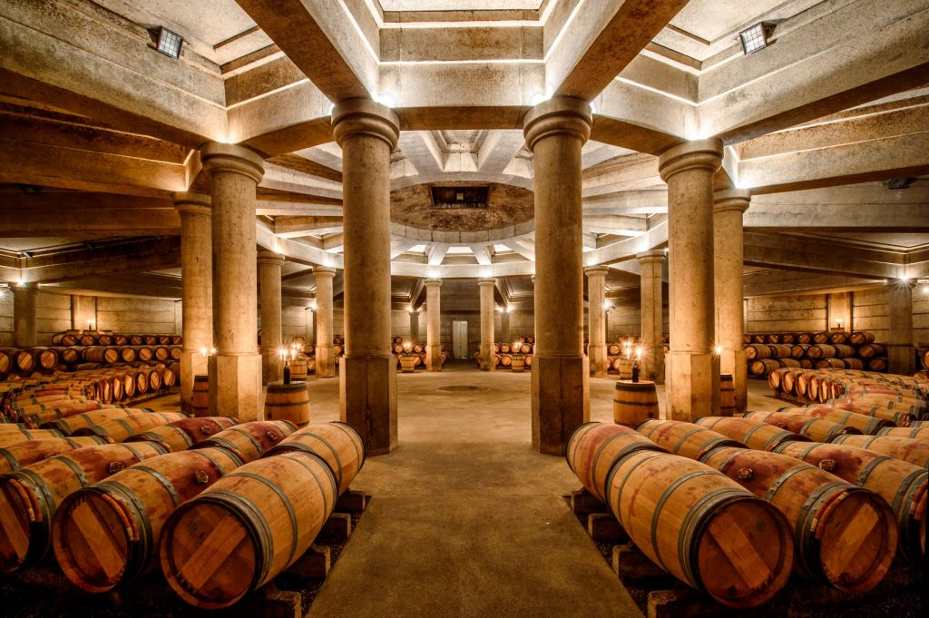 The cellars at Ch. Lafite, with barrels fanning out from central columns at the heart of the circular room.