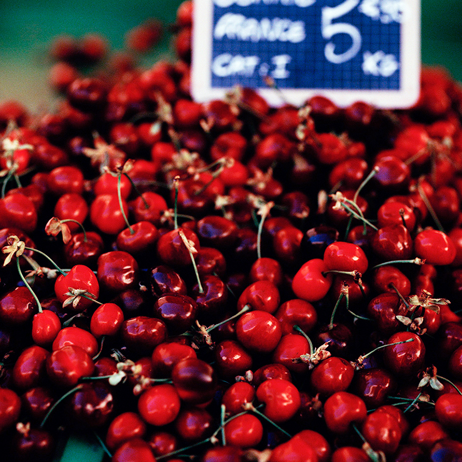 A photograph of a pile of cherries in Burgundy