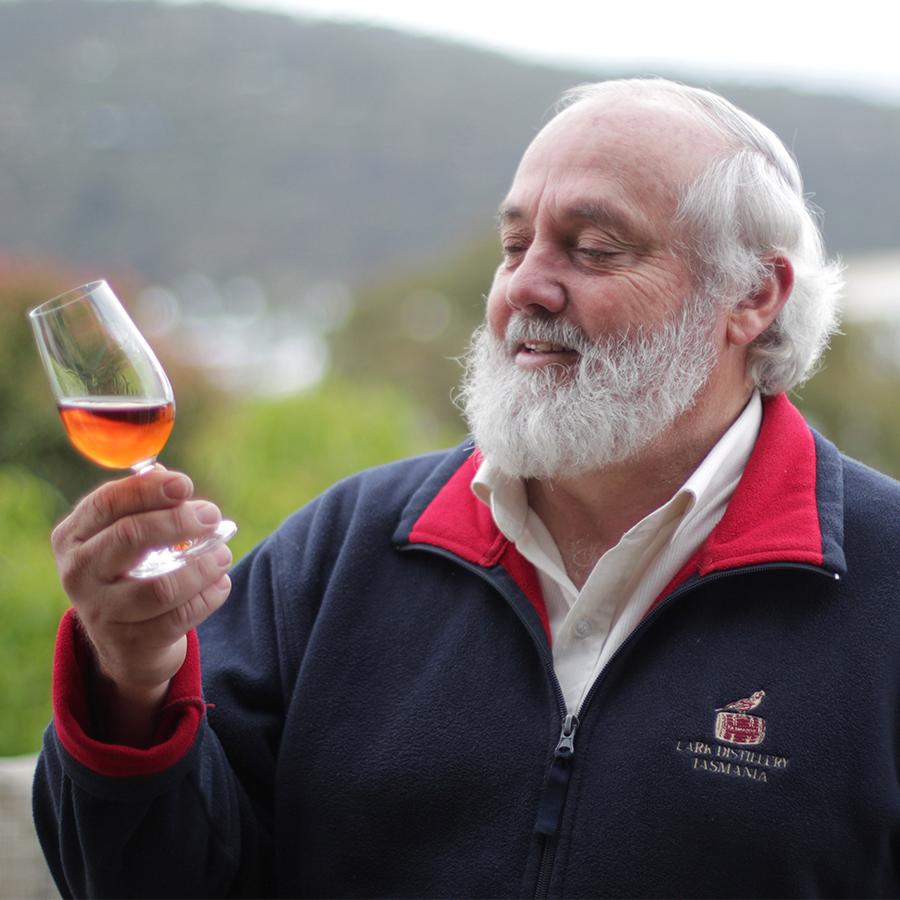 A photograph of Bill Lark, the founder of Lark Distillery.
