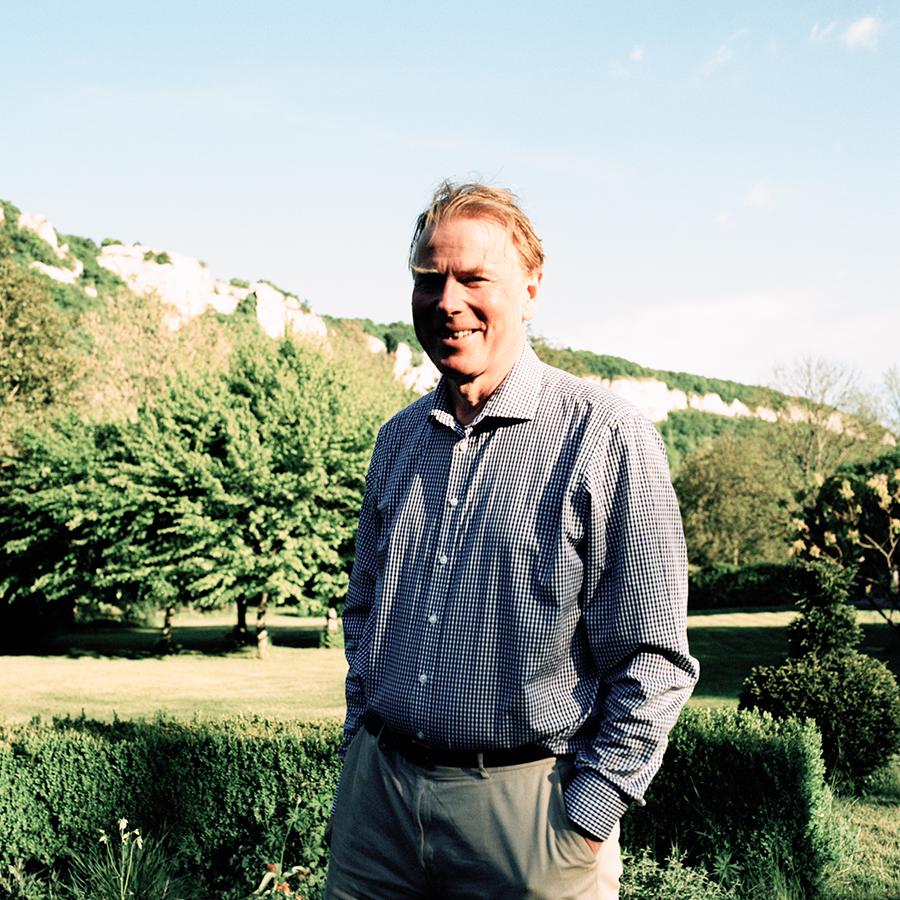 Jasper Morris MW stands against a natural backdrop in Burgundy