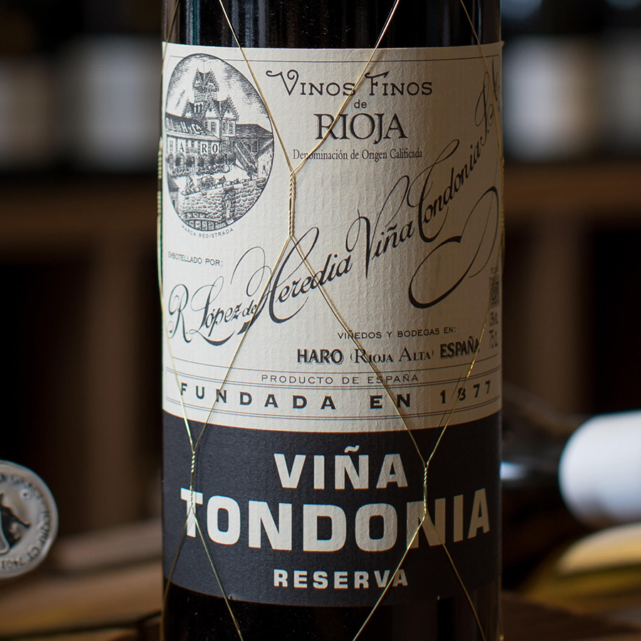 The 2009 vintage of Viña Tondonia stands on a wooden table in our London Shop, against a background of shelves of wine